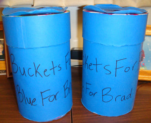 "These blue donation jars with ""Buckets for Brad"" written on them were passed around school throughout four days. More than $10,000 was collected for the Walls family."