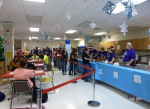 "Each year, the classroom is turned into a ""winter wonderland,"" by the fashion classes to accommodate the large event."