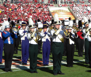 Fremd High School Band trumpet players Brian Jestice and Hannah Kuhl perform during half-time of the Outback Bowl in Tampa, Florida.