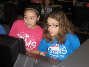 Michele Marasigan, a Conant High School sophomore, helps a GEMS participant during the 3D Modeling session.