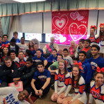 HEHS' wrestlers and cheerleaders volunteer at Alden Poplar Creek Rehabilitation and Health Center in Hoffman Estates.