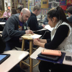 FHS student Kira Swearingen is registering to vote with social studies teacher and deputy registrar Jason Spoor-Harvey.