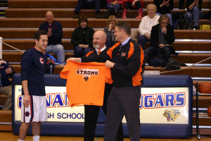 Joe receives a t-shirt from Washington High School Superintendent Dr. Jim Dunnan (left) and Assistant Superintendent  Joe Sander. The school officials traveled from Washington, Ill. to receive a $15,000 donation check for their school affected by tornadoes last Nov. The fundraising efforts were spearheaded by Ranallo with the help of Conant High School and the surrounding community.