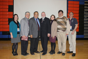 Picture of the dignitaries: (from L to R) District 54 School Board member Mary Kay Prusnick, State Representative Fred Crespo, Dr. Betances, Hoffman Estates Mayor McLeod, State Representative Michelle Mussman, Hanover Park Mayor Rodney Craig, and Hanover Park Trustee Jon Kunkel.