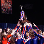 The CHS Co-Ed Varsity Cheerleading Team celebrate their second place trophy at the IHSA State Cheerleading Competition.