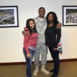 Trevor poses with his mother and sister at the  March 19 Board Meeting.