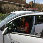 Nancy sits in the Chevy Spark after she won  the car courtesy of Operation Click.