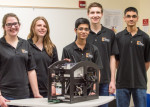 """Hawks Engineering Team poses with """"Seahawk,"""" the ROV they built for competition. (Right to left) Grace Wilkins, Laura Turf, Miraj Shah, Thomas Schaefer, and Dillon Vadgama."""
