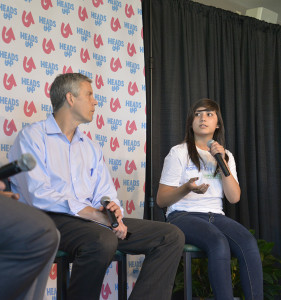 Ivette Castanon (center), a Palatine High School freshman, participated in a panel discussion with U.S. Secretary of Education Arne Duncan (left) at Harper College on Sept. 9.