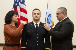 Joseph Zolper (center) with his parents during his Commissioning Ceremony this past December.