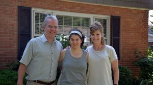 Allison Meehan poses with her parents at their home in Palatine, Ill.